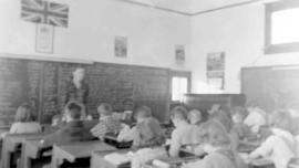 Students and teacher inside a school building