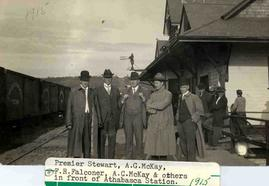 Premier Stewart, A.G. McKay, F.R. Falconer, A.C. McKay, and others in front of Athabasca Station