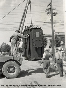 Winch truck transporting a transformer to the vault.