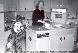 """Live Better...Electrically"" mascot in model kitchen with Virginia Lee of Calgary Power..."