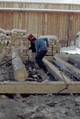 Fort Edmonton Park - Dwelling house - crew levelling ground for proper positioning of ground floo...