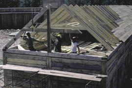 Fort Edmonton Park - Men's houses - south erecting last roof rafter