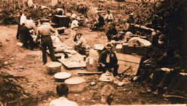 Men eating at a camp.