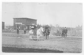 Girls on horseback and Grand Pacific Hotel, Edson, Alberta.