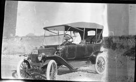 Janette Driving an Early Automobile in Medicine Hat