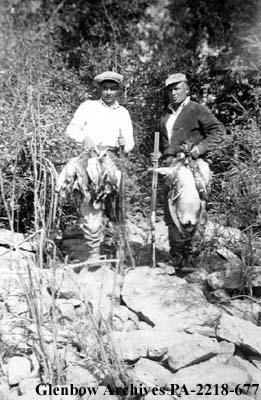 Louis Nabess and Pierre Carriere of Cumberland House, Saskatchewan, pose after a successful hunti...