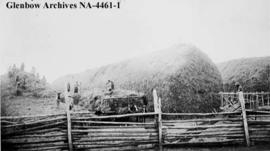 Men on Blood reserve putting up hay for Cochrane Ranche, Alberta.