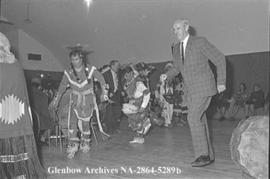 Lieutenant-Governor Grant MacEwan being received into the Stoney nation, Calgary, Alberta.