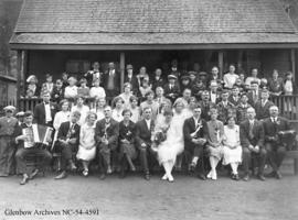 Large wedding party in front of house, Crowsnest Pass area, Alberta.