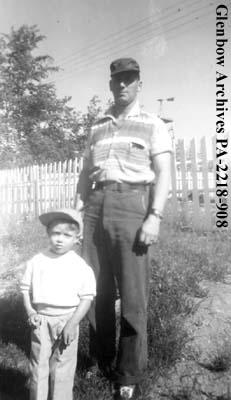 """Larry (Mac) Horne and son at Pelican Narrows, Saskatchewan""."