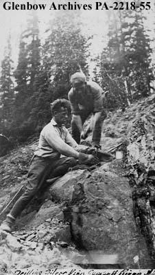 Two prospectors drilling a silver vein, Camsell River, Northwest Territories.