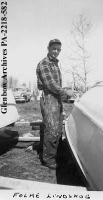 Folke Lindskog painting a boat, probably in Saskatchewan.