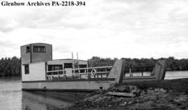 Converted Landing Craft Tank used by the Department of Natural Resources, on the Bigstone River, ...