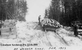 Load of logs on a sledge, Jahala Lake, Saskatchewan.