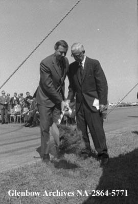 Honourable Robert Clark, left and Howard Wright in sod-turning ceremony, Calgary, Alberta.