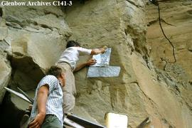 Selwyn Dewdney applying rice paper over petroglyph before tracing with a pencil,  Writing-on-Ston...