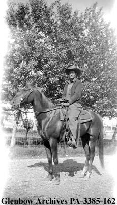 Joe Crowfoot on horseback, Blackfoot (Siksika) reserve, Alberta.