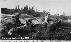 Canoeists preparing to portage on the Great Slave Lake to Great Bear Lake overland route, Northwe...