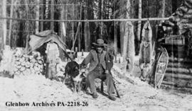 Abraham Plante, Metis trapper, with his dog and furs.
