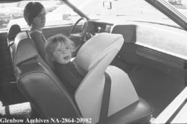 Safety belts and seats for children in cars, Calgary, Alberta.