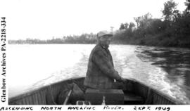 James Carriere navigating a motorized boat up the North Angling River, Saskatchewan.