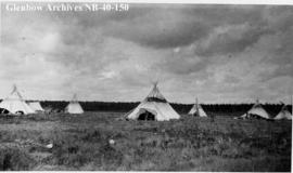 Ojibwa tipis around Hudson's Bay Company (HBC) post, Long Lake, Ontario.