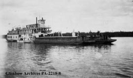 Stern-wheel steamer on the Slave River, shoring barges used for the transport of buffalo from rai...