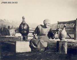 Unknown woman with turkey and goose at Milner Dairy.