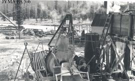 Cement mixer at the north abutment site of the Athabasca Bridge construction., Jasper National Pa...