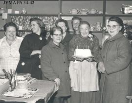 A group of women with Daisy Hartley, in her store, Jasper, Alberta.