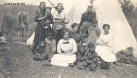 A nurse with a group of native americans.