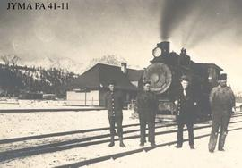 Engineers and a locomotive in front of the Fitzhugh Railroad Station, Jasper National Park, Alberta.