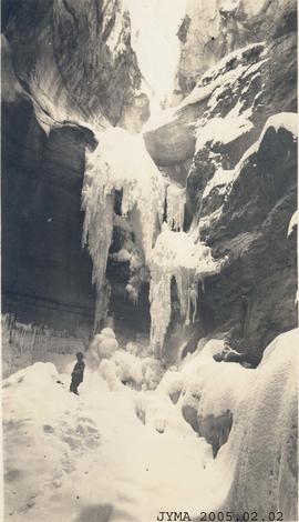 Person  in basin of Maligne Canyon during the winter.