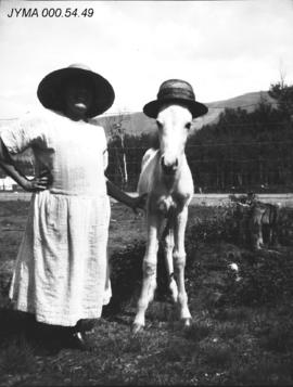 Woman with foal at Milner Dairy.
