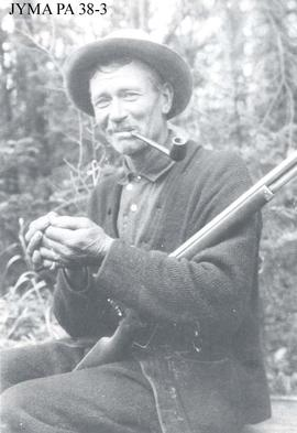 Daniel Alven Phillips, with his repeater hunting rifle.