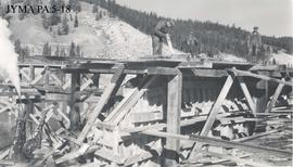 Pouring concrete at the south abutment during construction of the Athabasca Bridge, Jasper National Park, Alberta.