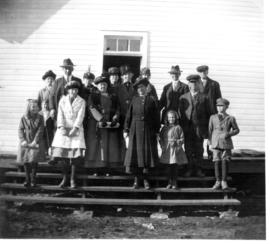 A group of Hillside residents on the steps of the Hillside School following church services.