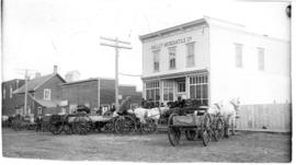 Horses and buggies parked in front of the Millet Mercantile Co.