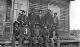 Group of men and boys in front of Le Goff, Cold Lake school, Alberta
