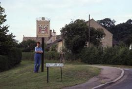 "Ann Southam in front of ""Southam Lane"" sign : [slide]"
