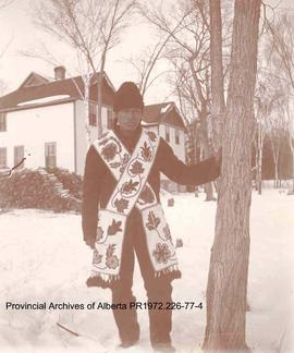 Chief Redsky standing in front of the Presbyterian Mission house at Shoal Lake Ontario