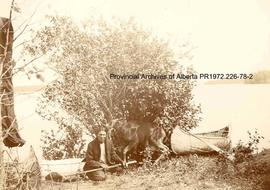 First Nations hunter with dead moose in the Lake of the Woods, Ontario area