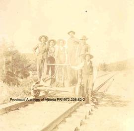 Railroad construction workers on a handcar, Ingolf, Ontario