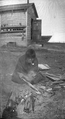 Aboriginal Woman Cutting Kindling