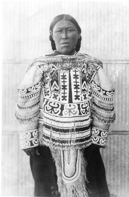 "An Inuit woman wearing a ""dear skin coat."