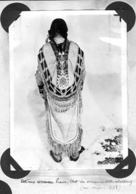 """Eskimo woman have test in ceremonial dress"""