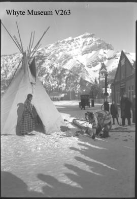 Indians setting up teepee on Banff Avenue
