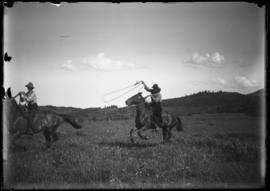 Elliott and Robert Barnes roping horses at Jumping Pound