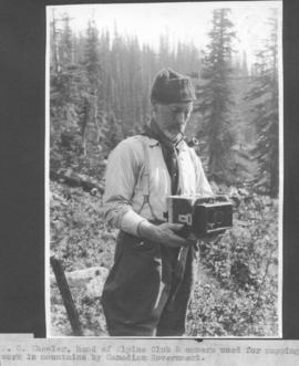 A. 0. Wheeler, head of Alpine Club & camera used for mapping work in mountains by Canadian Go...