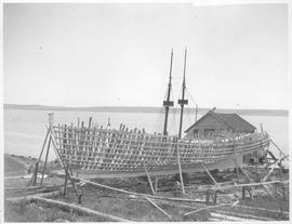 Canada (Nova Scotia). Fishing schooner being built near Shelburne on Nova Scotia's South sho...